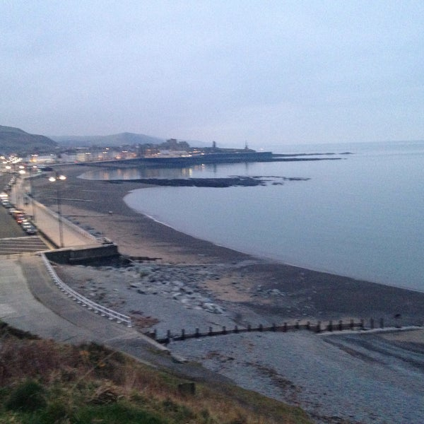 Photo taken at Aberystwyth Beach by Joe D. on 2/10/2015