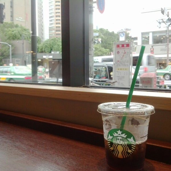 Photo taken at Starbucks Coffee 神楽坂下店 by jiro s. on 7/24/2013