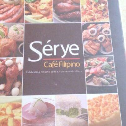 Photo taken at Sérye Café Filipino by Lyneth B. on 5/5/2013