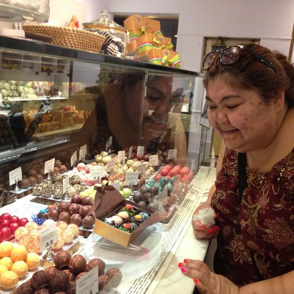 Photo taken at Godiva Chocolatier by Kellie on 6/29/2013