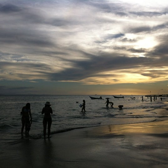 Photo taken at Playa El Yaque by Lolo's Travels on 12/15/2012