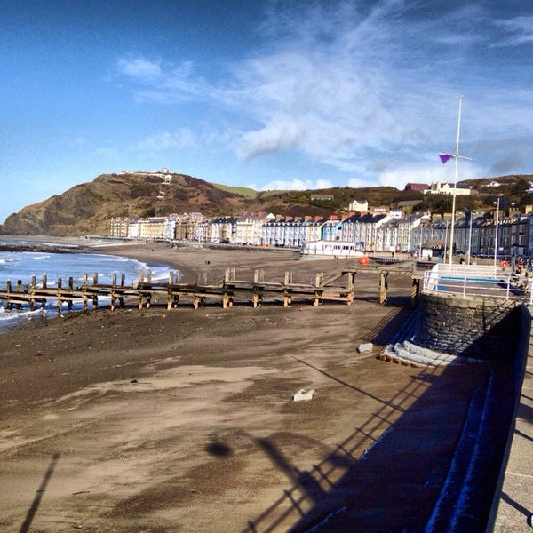 Photo taken at Aberystwyth Beach by Joe B. on 2/27/2014