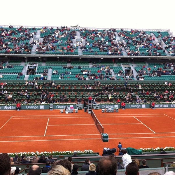 Photo taken at Stade Roland Garros by Alexander P. on 5/31/2013