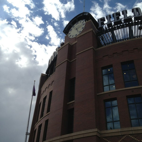 Photo taken at Coors Field by Vina T. on 5/16/2013