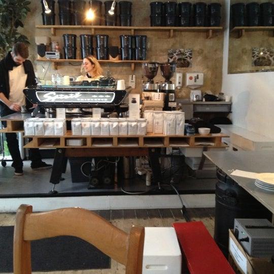 Photo taken at Bonanza Coffee Heroes by Ben W. on 12/6/2012