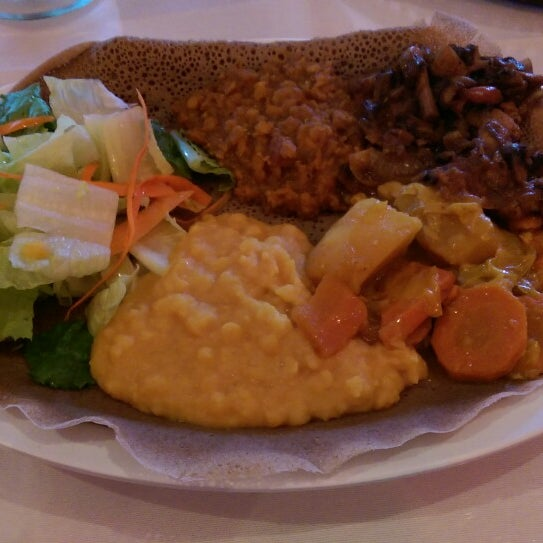 Photo taken at New Eritrea Restaurant & Bar by Adriano C. on 8/11/2014