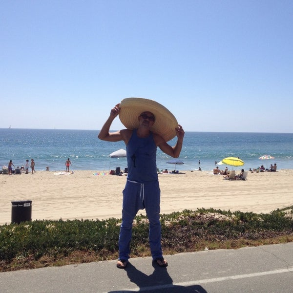 Photo taken at Pacific Palisades Beach by Vlad R. on 9/1/2014