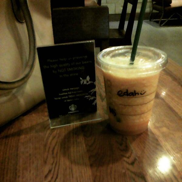 Photo taken at Starbucks by endah a. on 9/19/2015