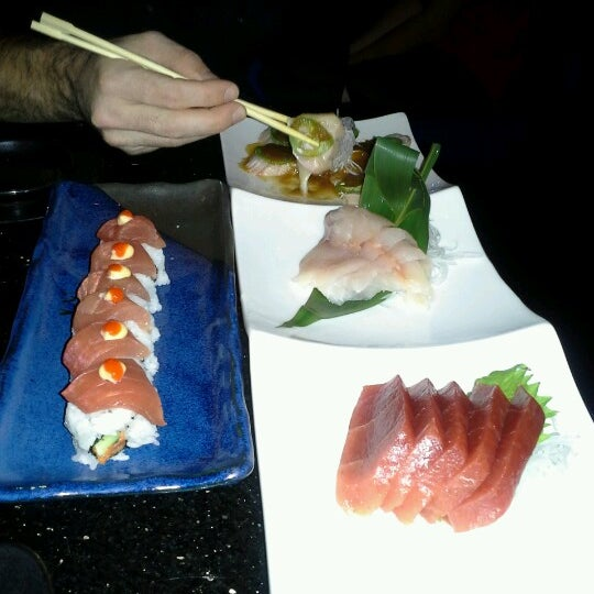 Photo taken at Blue Wasabi Sushi & Martini Bar by Hanan M. on 10/13/2012