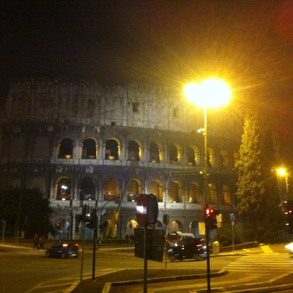 Photo taken at Piazza del Colosseo by Ali A. on 3/11/2014