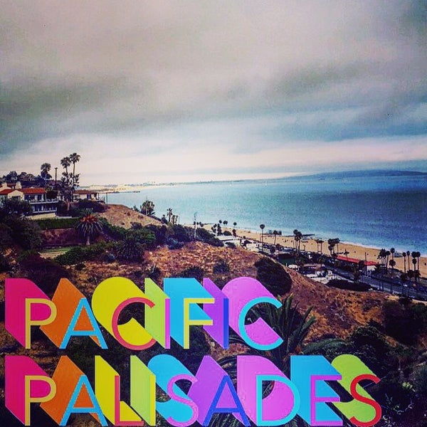 Photo taken at Pacific Palisades Beach by Chris V. on 6/14/2015