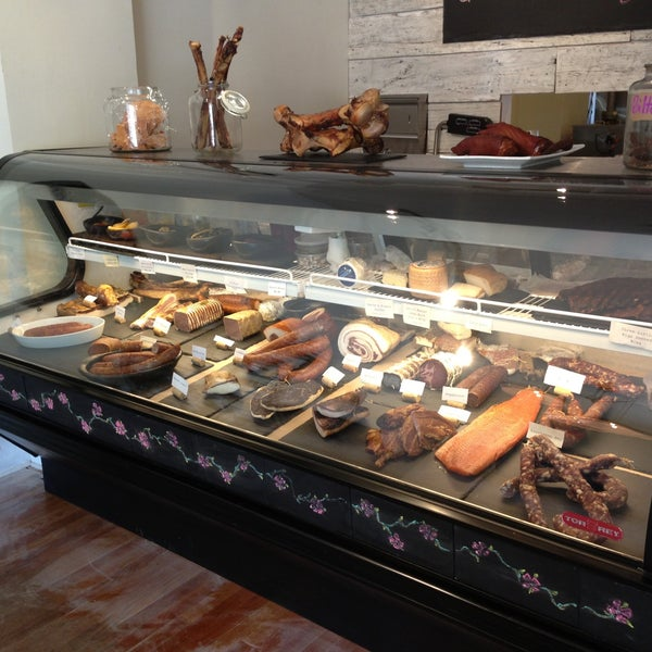 Photo taken at Three Little Pigs Charcuterie & Salumi by Laura on 5/2