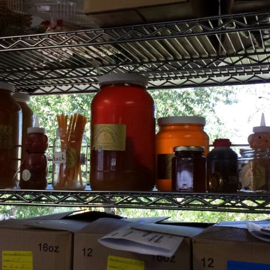 Photo taken at Marshall's Honey Farm by Thomas M. on 7/11/2013