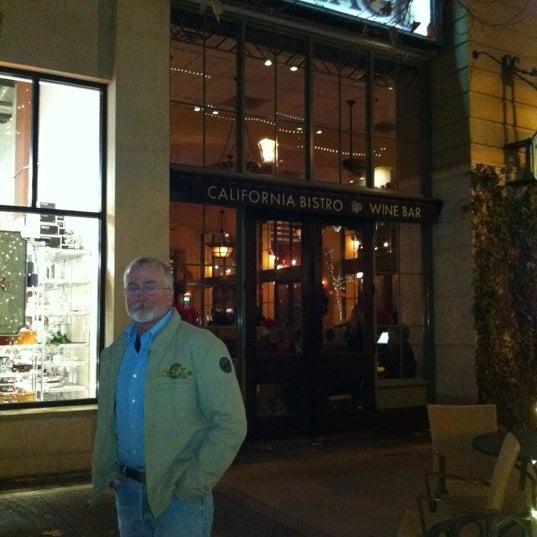 Photo taken at Village California Bistro & Wine Bar by Thaddeus C. on 12/23/2012