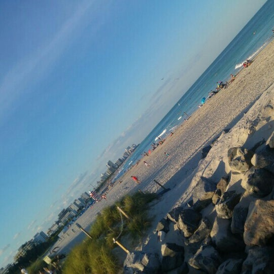 Photo taken at South Pointe Pier by Vitor V. on 4/7/2016