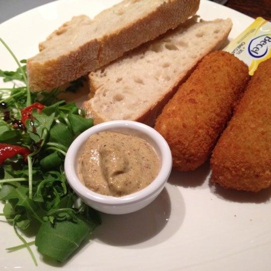 Photo taken at Grand Café Plaza by Eline on 12/12/2012