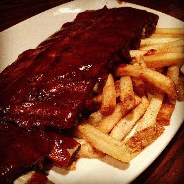 Foto tirada no(a) Outback Steakhouse por Rodrigo C. em 5/12/2013