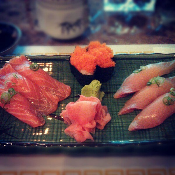 Photo taken at Sushi Tomo by Abby B. on 12/29/2012