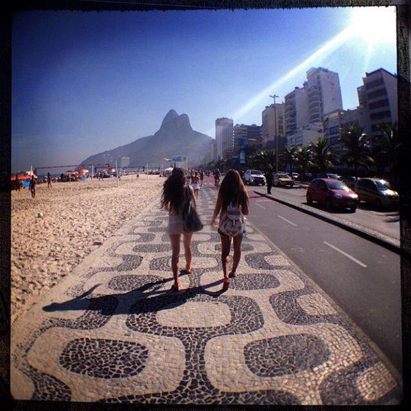Photo taken at Praia de Ipanema by Patrick F. on 5/4/2013
