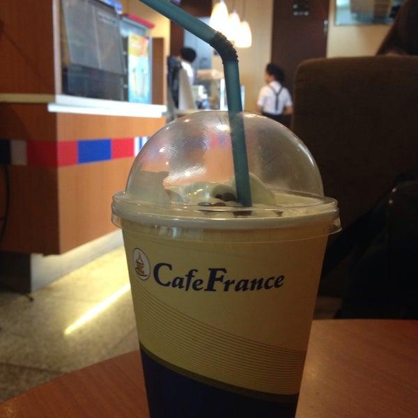 Photo taken at Café France by Natalie T. on 6/15/2014