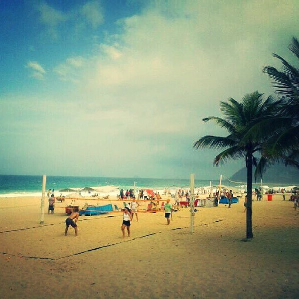 Photo taken at Praia de Ipanema by Monique C. on 7/21/2013