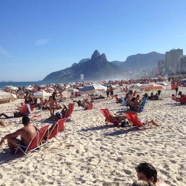 Photo taken at Praia de Ipanema by Marcelo V. on 7/6/2014