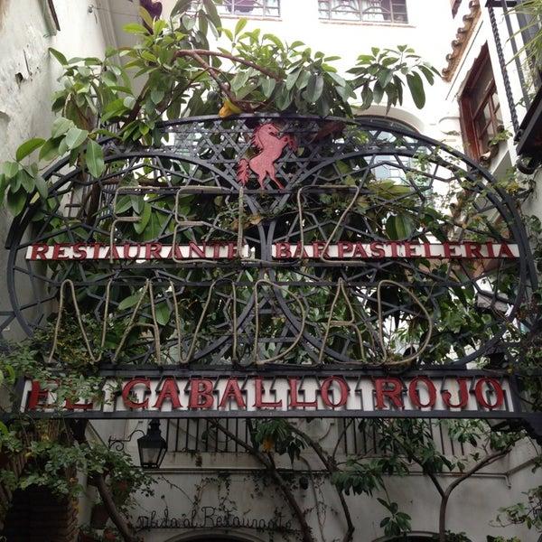 Photo taken at Restaurante El Caballo Rojo by Carlos P. on 12/25/2012