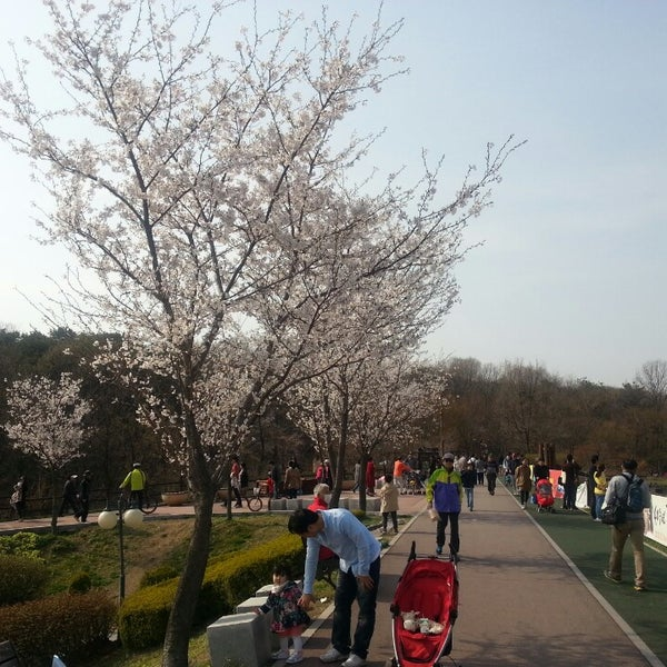 Photo taken at Yuldong Park by Alex C. on 4/21/2013