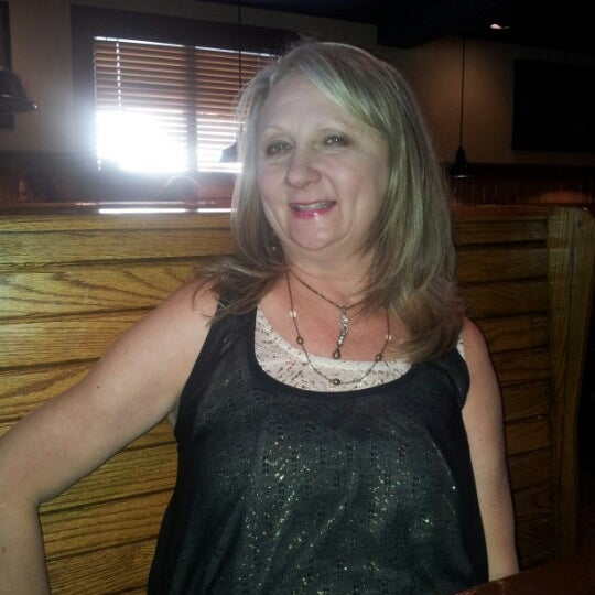 Photo taken at Outback Steakhouse by Tawny on 10/12/2012