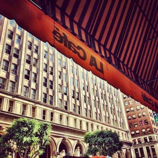 Photo taken at LA Café by Sarah C. on 10/4/2012