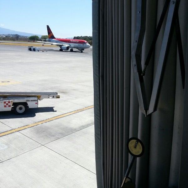 Photo taken at Gate 5 Aeropuerto Internacional Juan Santamaria by Luis C. on 2/16/2013