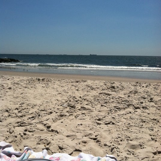 Photo taken at East Atlantic Beach by Hallie S. on 8/12/2011