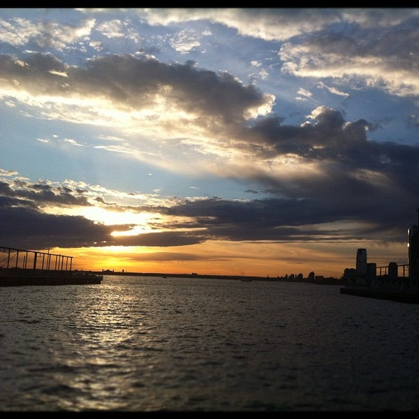 Photo taken at Brooklyn Bridge Park - Pier 6 by Kat E. on 4/17/2012