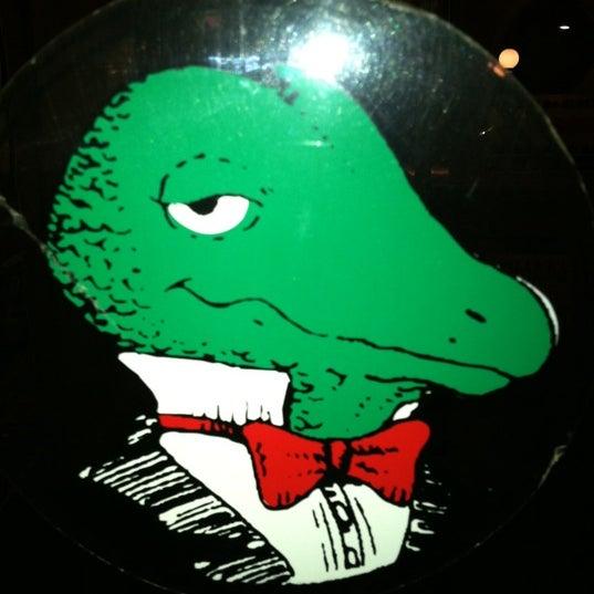 Photo taken at Winking Lizard Tavern by Jesse L. on 4/6/2012