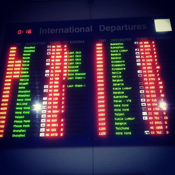 Photo taken at Tan Son Nhat International Airport (SGN) Sân Bay Quốc Tế Tân Sơn Nhất by mheeng on 7/26/2013