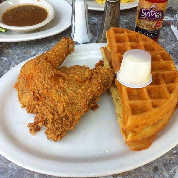 Photo taken at Sylvia's Restaurant by Kai N. on 7/26/2013