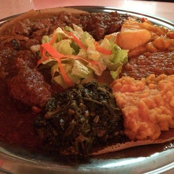 Photo taken at New Eritrea Restaurant & Bar by Jae Z. on 2/3/2014