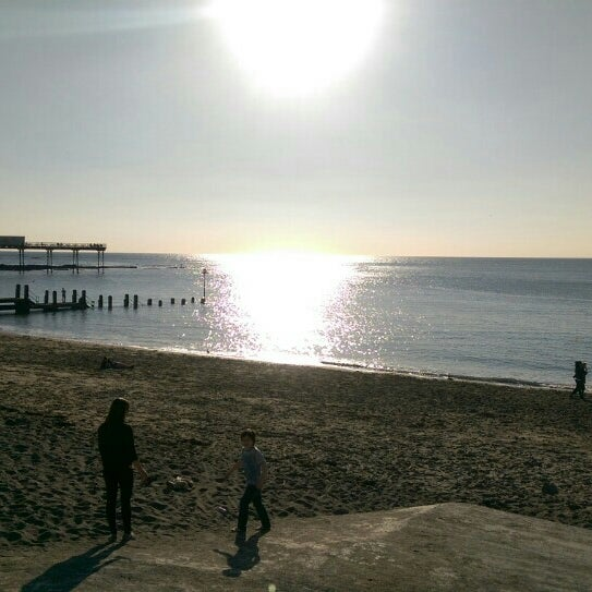 Photo taken at Aberystwyth Beach by Kevin D. on 4/18/2015