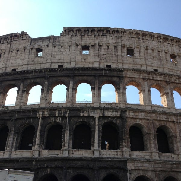 Photo taken at Piazza del Colosseo by Monica G. on 7/4/2013
