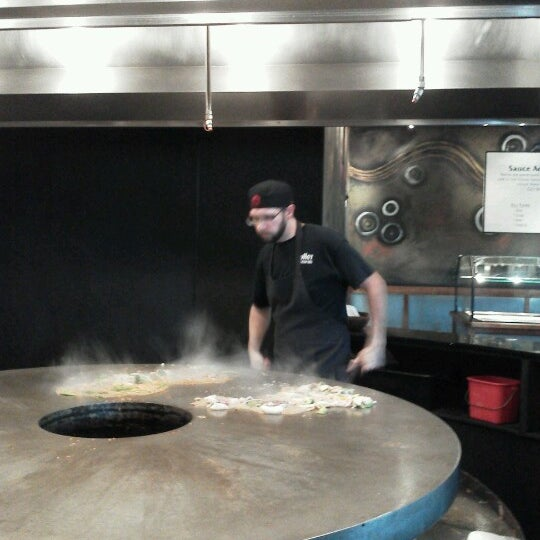 Photo taken at HuHot Mongolian Grill by Sara C. on 7/26/2013