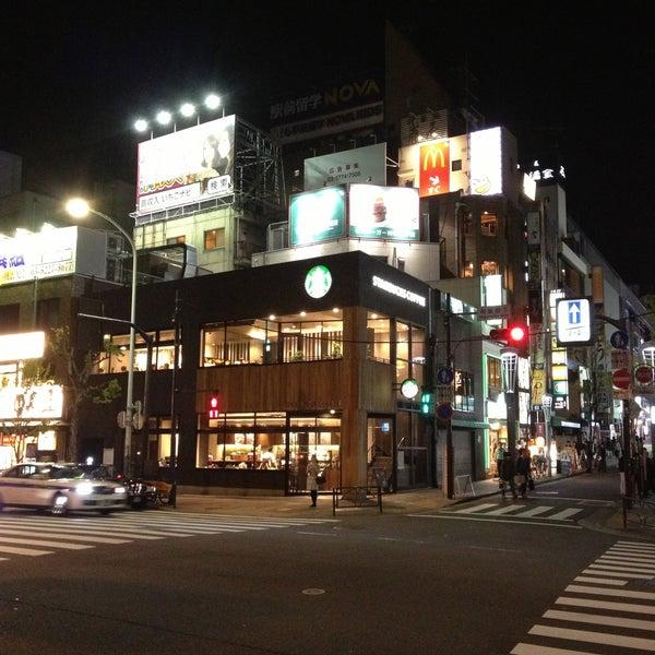 Photo taken at Starbucks Coffee 神楽坂下店 by kyuhara on 4/13/2013