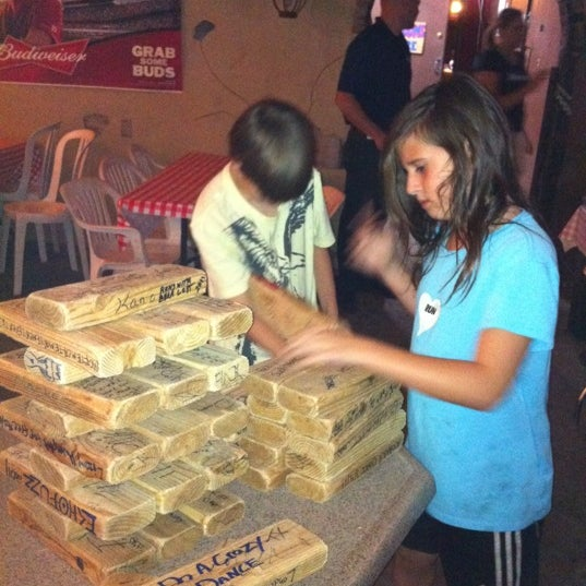You can bring dogs and kids.  Darts and giant jenga