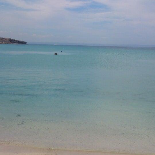 Photo taken at Playa Pichilingue by Edgar L. on 7/27/2014