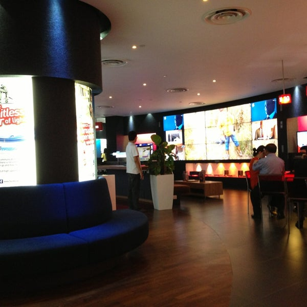 Photo taken at Singtel Shop by Alan L. on 12/24/2012