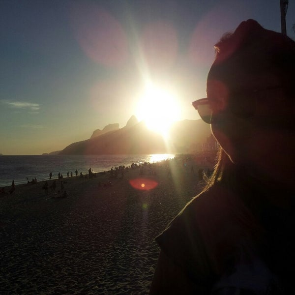 Photo taken at Praia de Ipanema by JacQue B. on 3/14/2014