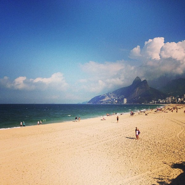 Photo taken at Praia de Ipanema by Carolina S. on 7/8/2013
