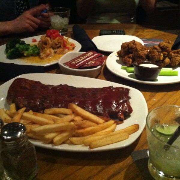 Foto tirada no(a) Outback Steakhouse por Eric V. em 5/15/2013