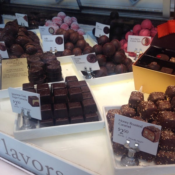 Photo taken at Godiva Chocolatier by Sydney Y. on 10/17/2014
