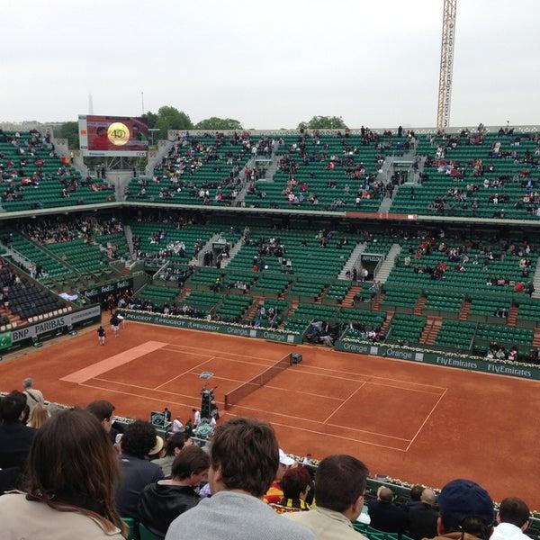 Photo taken at Stade Roland Garros by Charline M. on 6/9/2013