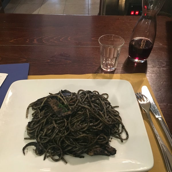 Calamari and wine of house. Mist try